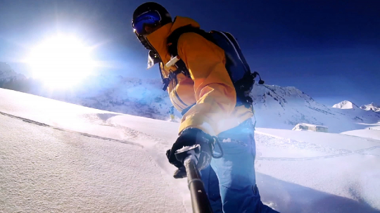 Man riding on snowboard with selfie stick in his hand- Stock Photo or Stock Video of rcfotostock | RC-Photo-Stock