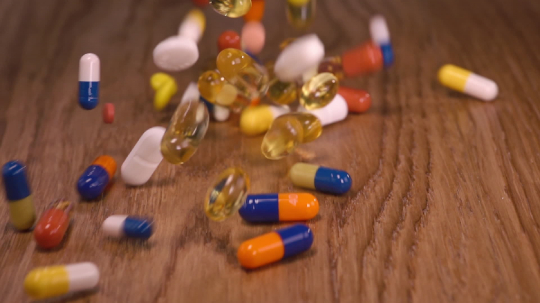 medical pills and coloured capsules falling down - authentic slow motion close up. Medical concept video - Stock Photo or Stock Video of rcfotostock | RC-Photo-Stock