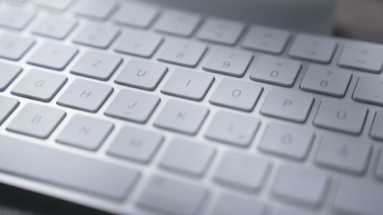very close Close-up  on keyboard in office -  smooth tracking shot- Stock Photo or Stock Video of rcfotostock | RC-Photo-Stock
