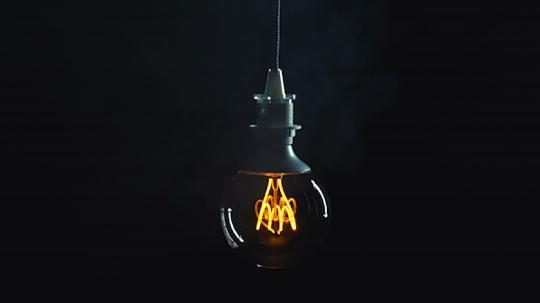 Vintage edison lightbulb swinging left and right on dark background - vintage technology revival.- Stock Photo or Stock Video of rcfotostock | RC-Photo-Stock