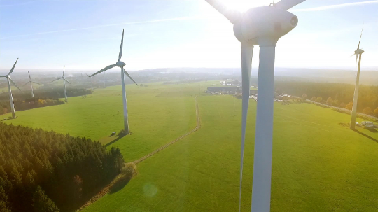 Wind turbines and agricultural fields on a summer day - Energy Production with clean and Renewable Energy - aerial shot- Stock Photo or Stock Video of rcfotostock   RC-Photo-Stock