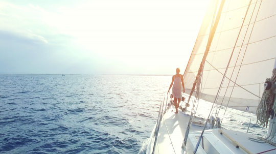 woman on big sailing boat or yacht on ocean at sunset- Stock Photo or Stock Video of rcfotostock | RC-Photo-Stock