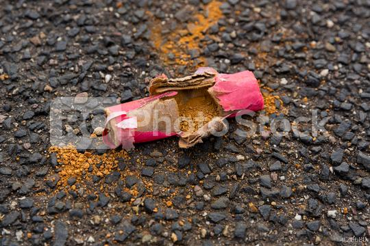 Scattered piece of a firecracker are spread on the ground.  : Stock Photo or Stock Video Download rcfotostock photos, images and assets rcfotostock | RC-Photo-Stock.:
