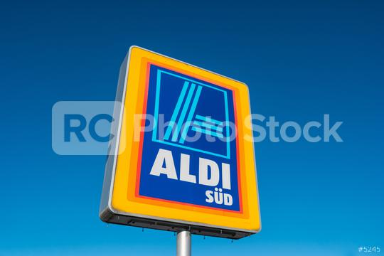 AAACHEN, GERMANY JANUARY, 2017: Aldi Süd logo against blue sky in germany  The German-based discount supermarket chain currently operates over 10,000 stores.  : Stock Photo or Stock Video Download rcfotostock photos, images and assets rcfotostock   RC-Photo-Stock.: