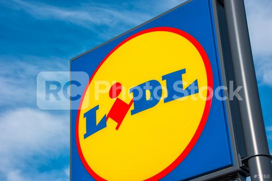 AACHEN, GERMANY JANUARY, 2017: LIDL supermarket chain sign against the blue cloudy sky. LIDL is a German global discount supermarket chain, based in Neckarsulm, Baden-Wuerttemberg, Germany.  : Stock Photo or Stock Video Download rcfotostock photos, images and assets rcfotostock   RC-Photo-Stock.: