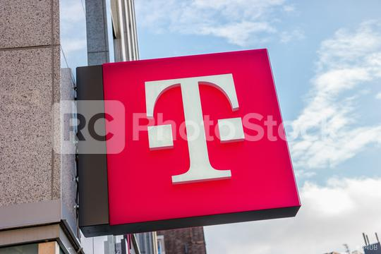 """AACHEN, GERMANY JANUARY, 2017: Logo of Deutsche Telekom on a shop. There are around 750 so called """"T-Punkt"""" shops which sell products and services of Deutsche Telekom.  : Stock Photo or Stock Video Download rcfotostock photos, images and assets rcfotostock   RC-Photo-Stock.:"""