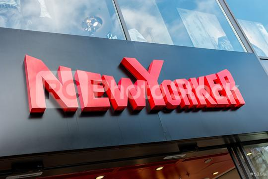 AACHEN, GERMANY JANUARY, 2017: New Yorker logo sign outside a store. This fashion store chain offers modern and stylish outfit for both men and women.  : Stock Photo or Stock Video Download rcfotostock photos, images and assets rcfotostock | RC-Photo-Stock.: