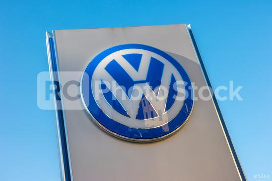 AACHEN, GERMANY JANUARY, 2017: Volkswagen sign against blue sky. Volkswagen is the biggest German automaker and the third largest automaker in the world.  : Stock Photo or Stock Video Download rcfotostock photos, images and assets rcfotostock | RC-Photo-Stock.: