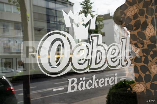AACHEN, GERMANY JULY 2019:  Oebel bakery Store Logo on a glass window. Headquartered in Aachen, Oebel is a bakery company since 1918, with bakeries and bakery cafes in Aachen and around NRW.  : Stock Photo or Stock Video Download rcfotostock photos, images and assets rcfotostock | RC-Photo-Stock.: