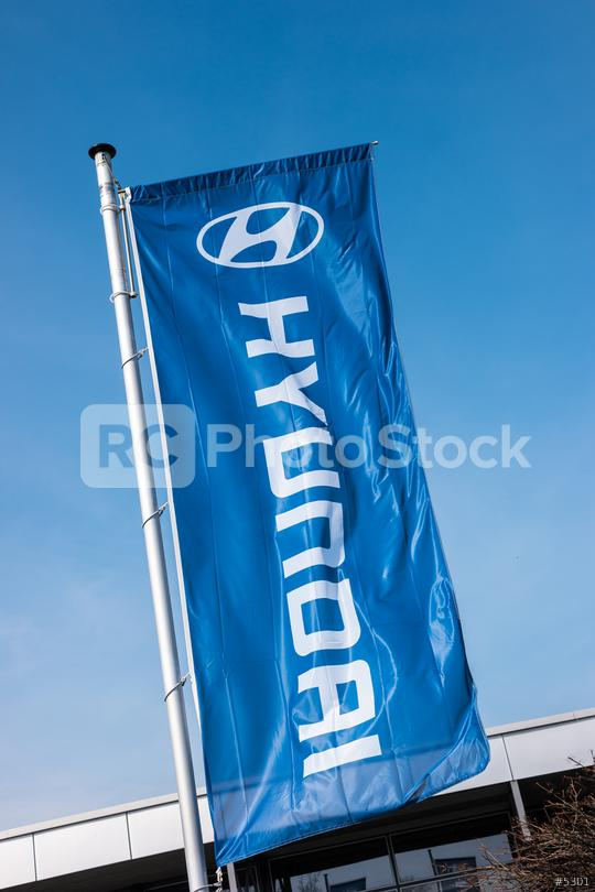AACHEN, GERMANY MARCH, 2017: Hyundai flag against blue sky. Hyundai Motor Company is a South Korean multinational automotive manufacturer founded at 1967.  : Stock Photo or Stock Video Download rcfotostock photos, images and assets rcfotostock | RC-Photo-Stock.: