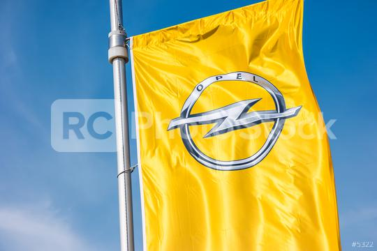 AACHEN, GERMANY MARCH, 2017: Opel flag closeup against blue sky at the Opel Store. Opel AG is a German automobile manufacturer.  : Stock Photo or Stock Video Download rcfotostock photos, images and assets rcfotostock | RC-Photo-Stock.: