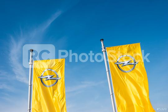 AACHEN, GERMANY MARCH, 2017: Opel flags against blue sky at the Opel Store. Opel AG is a German automobile manufacturer.  : Stock Photo or Stock Video Download rcfotostock photos, images and assets rcfotostock | RC-Photo-Stock.:
