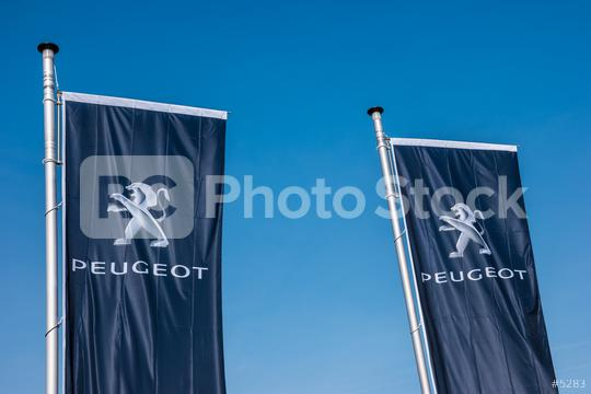AACHEN, GERMANY MARCH, 2017: Peugeot flags against blue sky at the Peugeot Store. Peugeot is a French cars brand, part of PSA Peugeot Citroen.  : Stock Photo or Stock Video Download rcfotostock photos, images and assets rcfotostock   RC-Photo-Stock.: