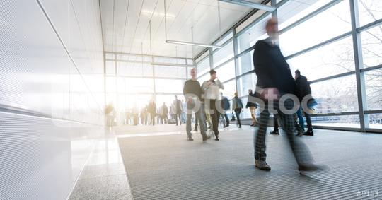 Abstract Image of businesspeople walking on tradeshow entrance  : Stock Photo or Stock Video Download rcfotostock photos, images and assets rcfotostock | RC-Photo-Stock.: