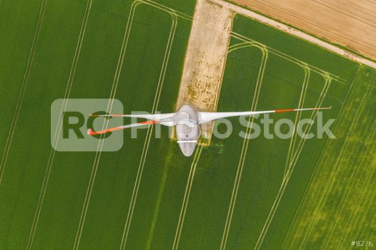 Aerial top down picture of wind turbine a device that converts the wind