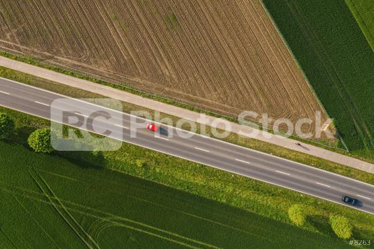 Aerial view of two lane road through countryside and cultivated fields with cars. Drone shot  : Stock Photo or Stock Video Download rcfotostock photos, images and assets rcfotostock | RC-Photo-Stock.:
