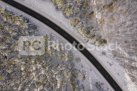 Aerial view of winter road in snowy forest. Drone captured shot from above  : Stock Photo or Stock Video Download rcfotostock photos, images and assets rcfotostock | RC-Photo-Stock.: