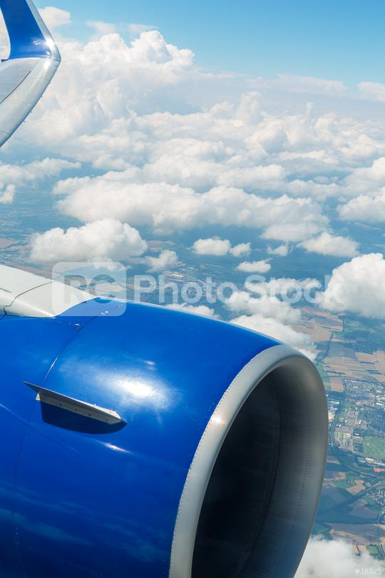 Airplane window view over the clouds  : Stock Photo or Stock Video Download rcfotostock photos, images and assets rcfotostock | RC-Photo-Stock.: