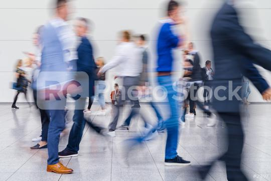 Anonymous crowd of business people go by gear on a trade fair  : Stock Photo or Stock Video Download rcfotostock photos, images and assets rcfotostock | RC-Photo-Stock.: