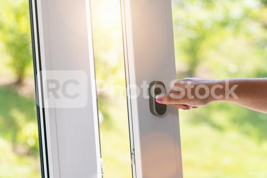 arm open white plastic window with garden view  : Stock Photo or Stock Video Download rcfotostock photos, images and assets rcfotostock   RC-Photo-Stock.:
