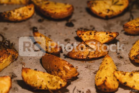 Baked potato wedges on baking paper -  homemade organic vegetable vegan vegetarian potato wedges snack food meal.  : Stock Photo or Stock Video Download rcfotostock photos, images and assets rcfotostock | RC-Photo-Stock.: