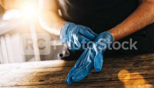 bartender or employee wearing a medical Latex gloves at work to prevent Coronavirus corona virus covid 19 infection.  : Stock Photo or Stock Video Download rcfotostock photos, images and assets rcfotostock | RC-Photo-Stock.: