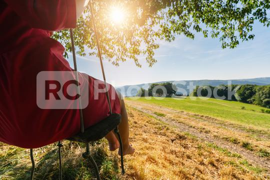 Beautiful girl on the sitting on a swing with copy space  : Stock Photo or Stock Video Download rcfotostock photos, images and assets rcfotostock | RC-Photo-Stock.: