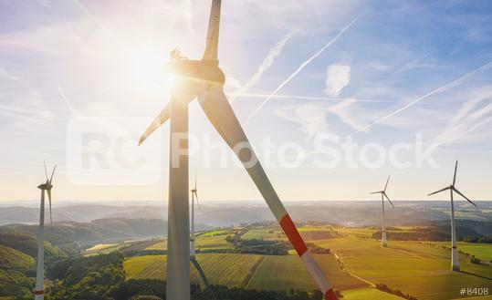 Beautiful sunset above the windmills on the field  : Stock Photo or Stock Video Download rcfotostock photos, images and assets rcfotostock   RC-Photo-Stock.: