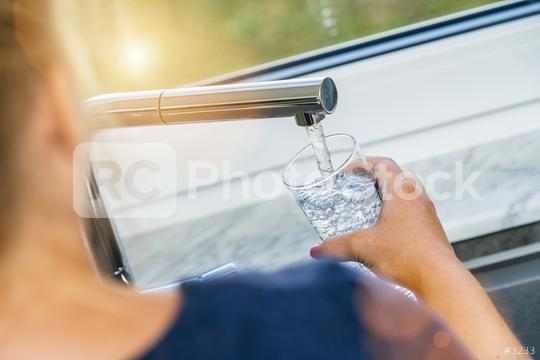 Beautiful woman filling glass with water in kitchen  : Stock Photo or Stock Video Download rcfotostock photos, images and assets rcfotostock | RC-Photo-Stock.: