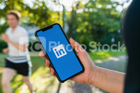 BERLIN, GERMANY AUGUST 2019: Woman hand holding iphone Xs with logo of LinkedIn application on the screen. LinkedIn is a business-oriented social networking service.  : Stock Photo or Stock Video Download rcfotostock photos, images and assets rcfotostock | RC-Photo-Stock.: