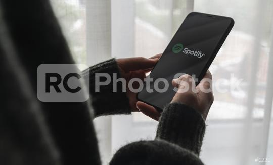 BERLIN, GERMANY AUGUST 2019: Woman holding a iPhone Xs opening spotify app on a window, Spotify is a music service that offers legal streaming music.  : Stock Photo or Stock Video Download rcfotostock photos, images and assets rcfotostock | RC-Photo-Stock.: