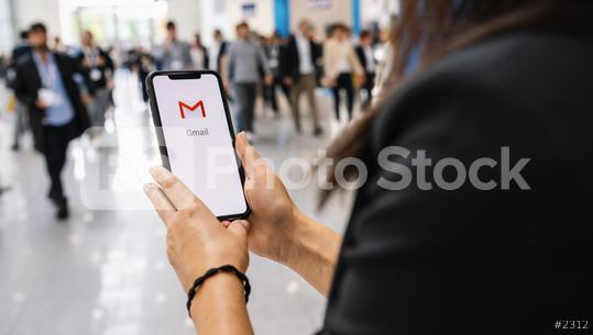 BERLIN, GERMANY JANUARY 2020: Business woman holding a iPhone with Google Gmail app logo on the display. Gmail is a most popular free Internet e-mail service provided by Google.  : Stock Photo or Stock Video Download rcfotostock photos, images and assets rcfotostock | RC-Photo-Stock.:
