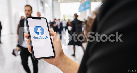 BERLIN, GERMANY JANUARY 2020: Woman hand holding iphone Xs with logo of Facebook application in a pedestrian zone. Facebook is an online social networking service founded February 2004 Mark Zuckerberg  : Stock Photo or Stock Video Download rcfotostock photos, images and assets rcfotostock | RC-Photo-Stock.: