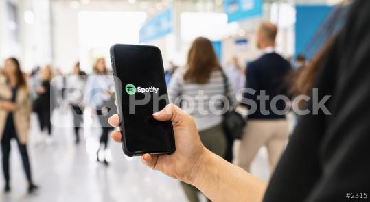 BERLIN, GERMANY JANUARY 2020: Woman holding a iPhone Xs opening spotify app, Spotify is a music service that offers legal streaming music.  : Stock Photo or Stock Video Download rcfotostock photos, images and assets rcfotostock | RC-Photo-Stock.: