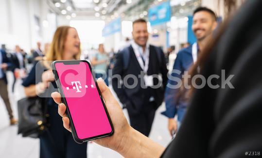 BERLIN, GERMANY JANUARY 2020: Woman holding a iPhone Xs opening Tmobile Apple Application on Screen, T-Mobile is a mobile communications company. #T-Mobile.  : Stock Photo or Stock Video Download rcfotostock photos, images and assets rcfotostock | RC-Photo-Stock.:
