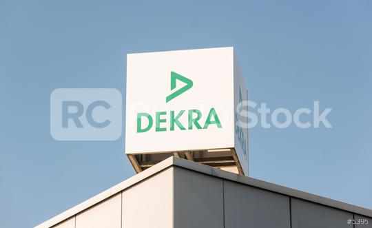 BERLIN, GERMANY JULY 2019: Dekra logo on a building. Dekra is a vehicle inspection company founded in Berlin, Germany in 1925. Dekra is the third largest inspection company in the world  : Stock Photo or Stock Video Download rcfotostock photos, images and assets rcfotostock | RC-Photo-Stock.: