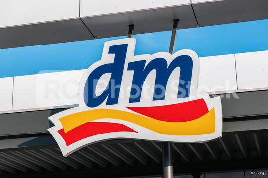 BERLIN, GERMANY JULY 2019: Logo of dm store. dm-drogerie markt is a chain of retail stores that sells cosmetics, healthcare and health food.   : Stock Photo or Stock Video Download rcfotostock photos, images and assets rcfotostock   RC-Photo-Stock.: