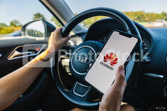 BERLIN, GERMANY JULY 2019: Woman hand holding iphone Xs with HUAWEI logo on screen in a car. Huawei Technologies Co., Ltd. is a Chinese multinational networking and telecommunications equipment.  : Stock Photo or Stock Video Download rcfotostock photos, images and assets rcfotostock | RC-Photo-Stock.: