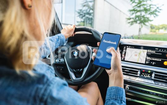 BERLIN, GERMANY JULY 2019: Woman hand holding iphone Xs with logo of Facebook application in a car. Facebook is an online social networking service founded in February 2004 by Mark Zuckerberg.  : Stock Photo or Stock Video Download rcfotostock photos, images and assets rcfotostock | RC-Photo-Stock.: