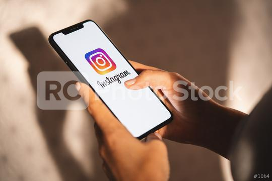 BERLIN, GERMANY JULY 2019: Woman hand holding iphone Xs with logo of instagram application. Instagram is largest and most popular photograph social networking.  : Stock Photo or Stock Video Download rcfotostock photos, images and assets rcfotostock | RC-Photo-Stock.: