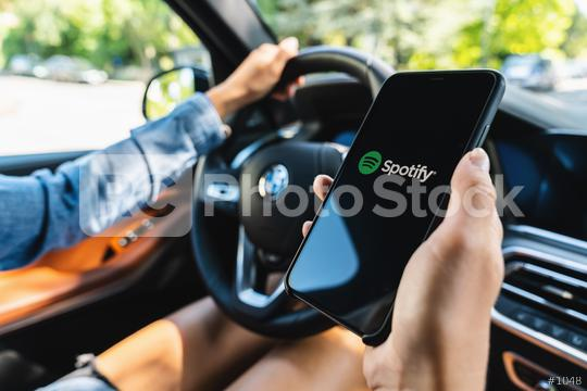 BERLIN, GERMANY JULY 2019: Woman holding a iPhone Xs opening spotify app in a car, Spotify is a music service that offers legal streaming music.  : Stock Photo or Stock Video Download rcfotostock photos, images and assets rcfotostock   RC-Photo-Stock.: