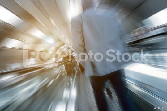 Blurred business commuters on a indoor walkway  : Stock Photo or Stock Video Download rcfotostock photos, images and assets rcfotostock   RC-Photo-Stock.: