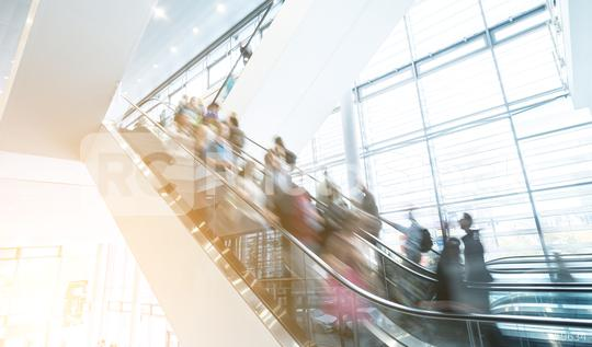 Blurred business people at a trade fair escalators in motion  : Stock Photo or Stock Video Download rcfotostock photos, images and assets rcfotostock | RC-Photo-Stock.: