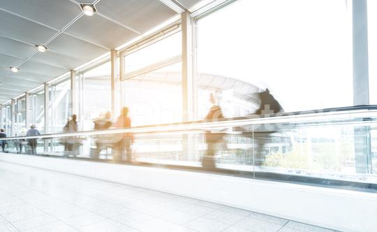 Blurred business people at a trade fair on a skywalk/staircase  : Stock Photo or Stock Video Download rcfotostock photos, images and assets rcfotostock | RC-Photo-Stock.: