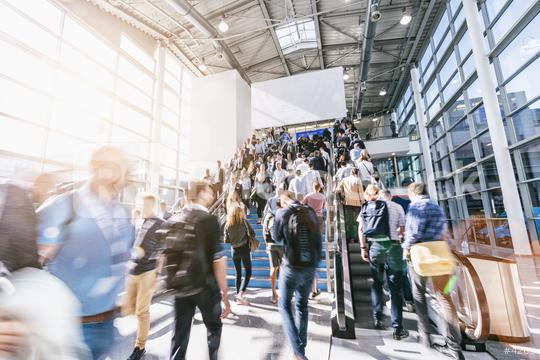blurred business people at a trade fair, with banner for copy space  : Stock Photo or Stock Video Download rcfotostock photos, images and assets rcfotostock | RC-Photo-Stock.: