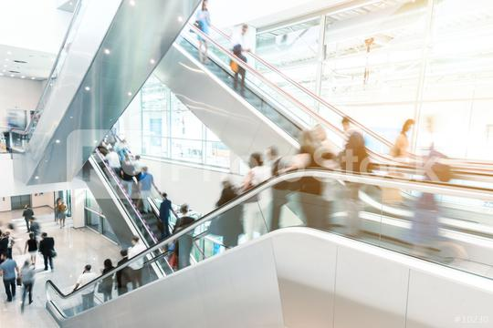 Blurred business people on a escalator  : Stock Photo or Stock Video Download rcfotostock photos, images and assets rcfotostock | RC-Photo-Stock.: