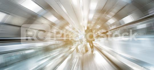Blurred business people on a futuristic indoor walkway  : Stock Photo or Stock Video Download rcfotostock photos, images and assets rcfotostock | RC-Photo-Stock.:
