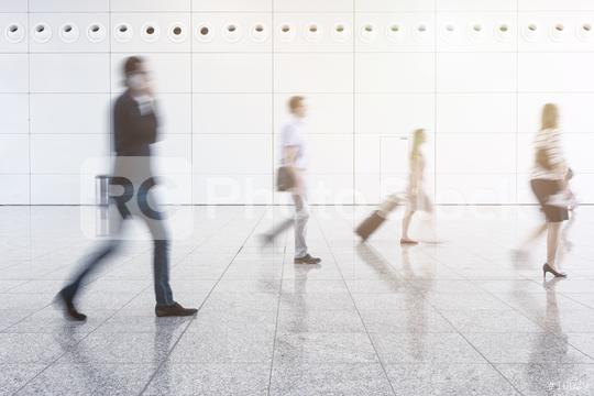 Blurred business people walking at corridor in convention hall  : Stock Photo or Stock Video Download rcfotostock photos, images and assets rcfotostock | RC-Photo-Stock.:
