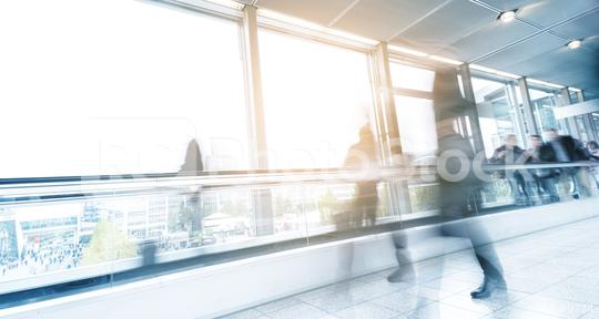 blurred commuters walking on a escalator  : Stock Photo or Stock Video Download rcfotostock photos, images and assets rcfotostock | RC-Photo-Stock.: