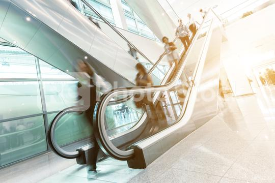 Blurred trade fair visitors at a escalator  : Stock Photo or Stock Video Download rcfotostock photos, images and assets rcfotostock | RC-Photo-Stock.: